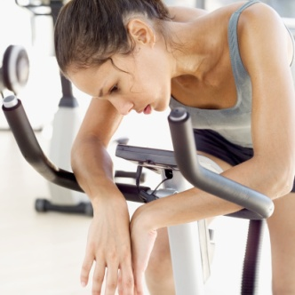 young woman sitting on an exercise bike